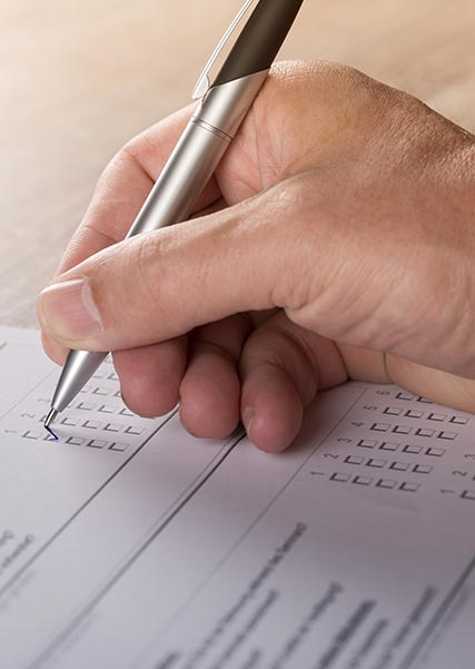 Hand Filling Out Form