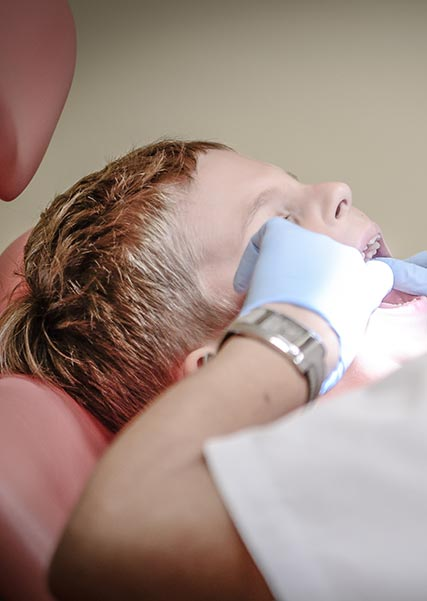 Dentist working on Child's Teeth