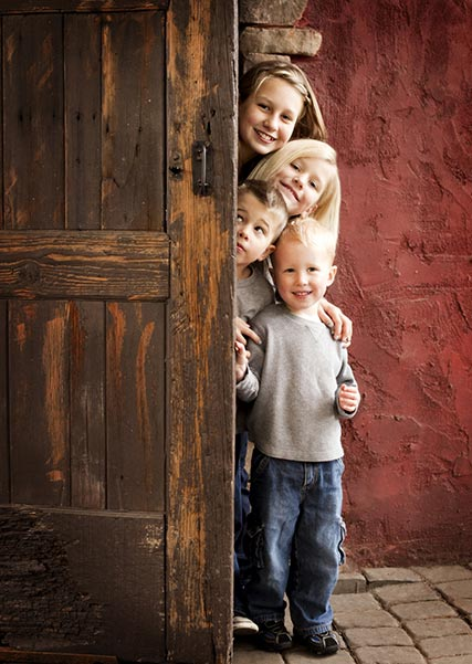 Kids looking around door